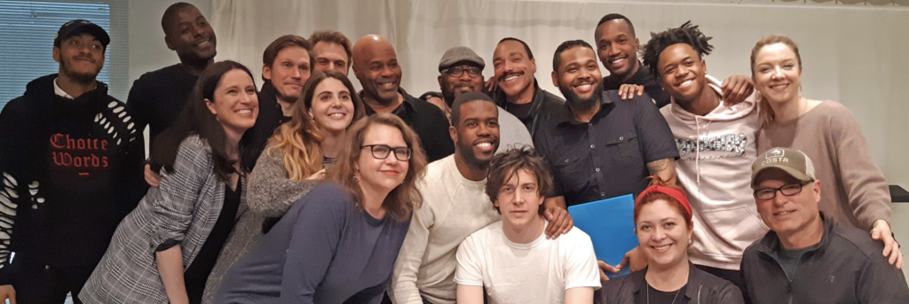 Cast members and directors smiling at camera